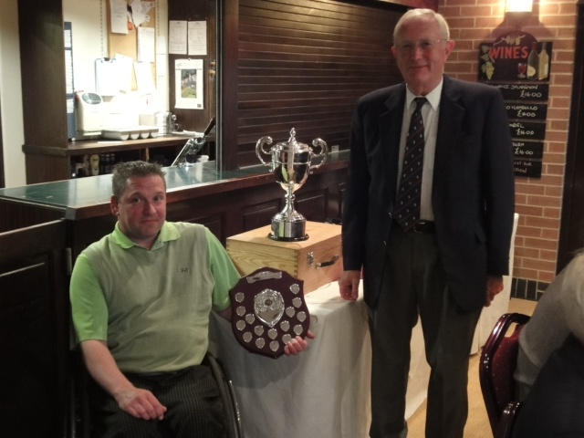 Phil Meadows receives the Nationals and Southern Open from Eric Tofield