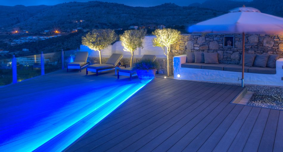Rear deck area bathed in soft blue lighting for evening elegance