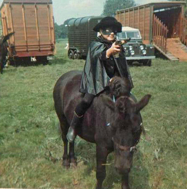 midget riding a pony