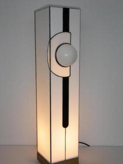 light on oak base with white glass globe set in white circle wirh dark purple stripe