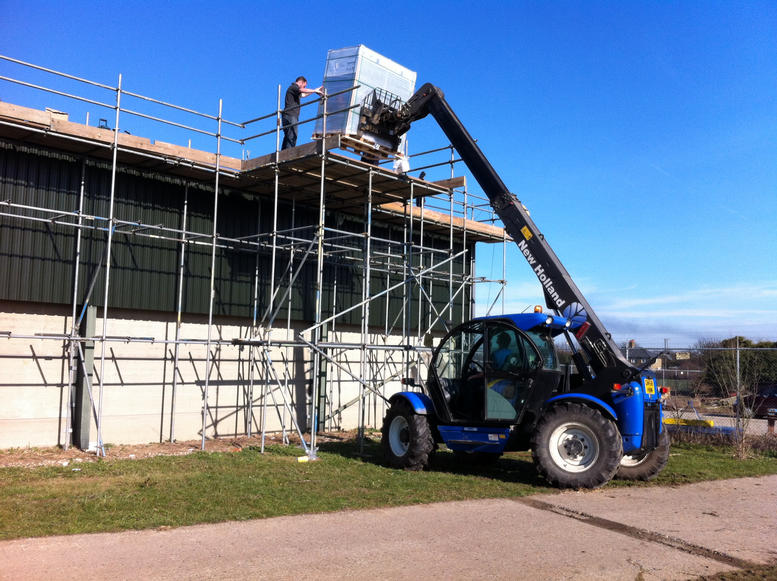 Loading panels onto the roof