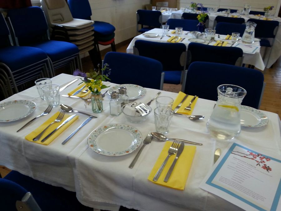 The tables set for an April Lunch