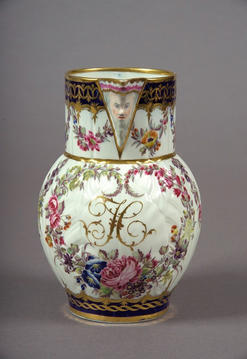 A delightfully decorated Caughley mask head jug shown at the 'Caughley in Colour' exhibition 2005