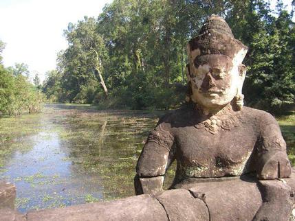 Statue and moat at entrance to Preah Khan, Angkor