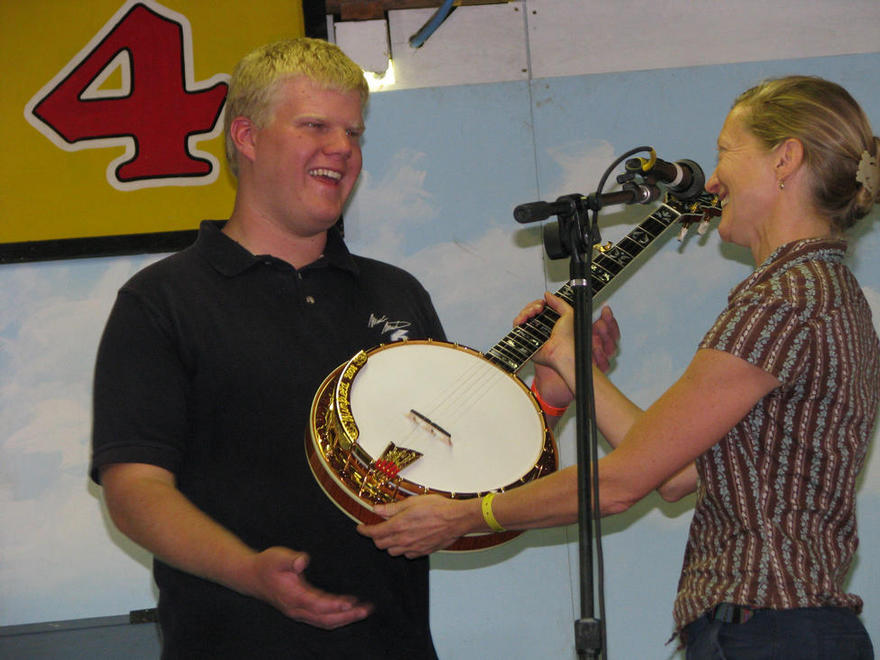 Tanya Ogsbury from Ome Banjos Hands Steven a Beautiful Ome Banjo