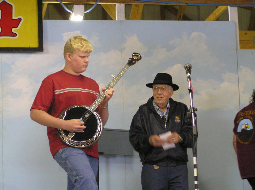The third place prize is a Deering Black Diamond Banjo and Elliot Capo
