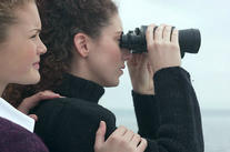 Women looking through binoculars