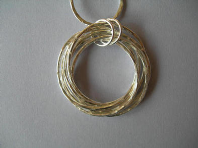Mobius, pendants earrings and bracelets.