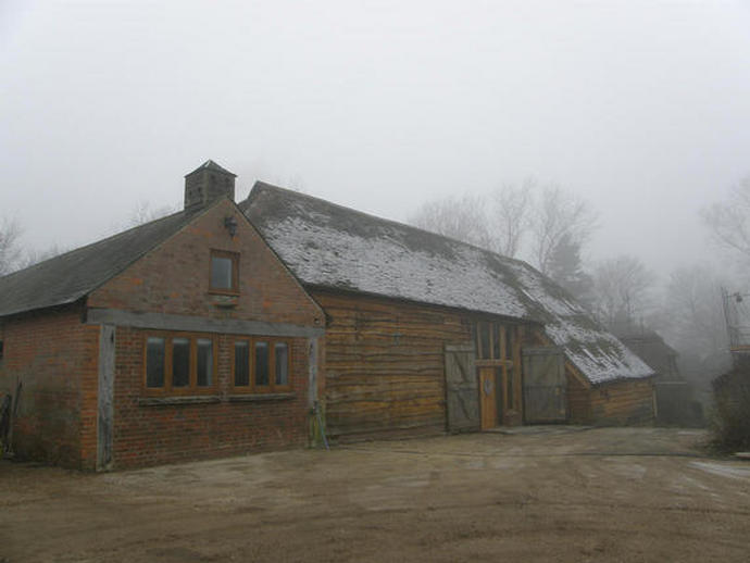 The finished Barn, shrouded in late afternoon mist