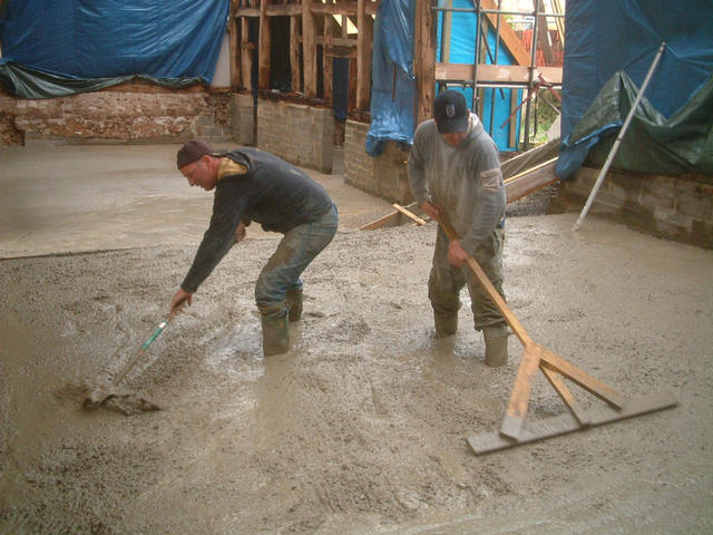 Dean and Pip spreading the concrete