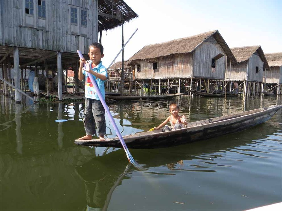 Inle children rowing on the lake