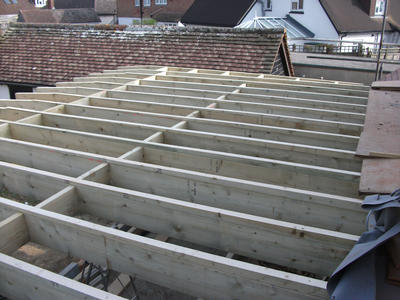 Flat roof joist in, solid bridge noggins fitted, and firring battens on