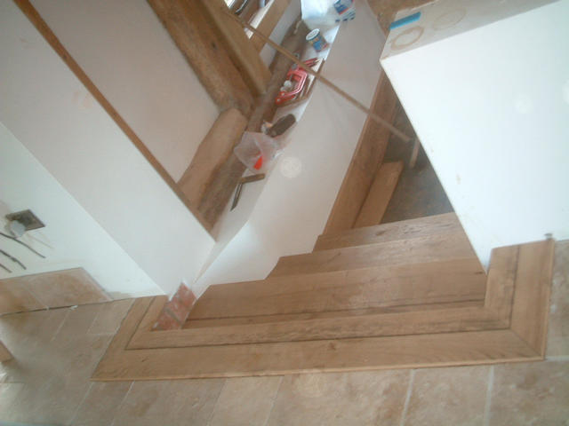 Oak steps from kitchen to lounge