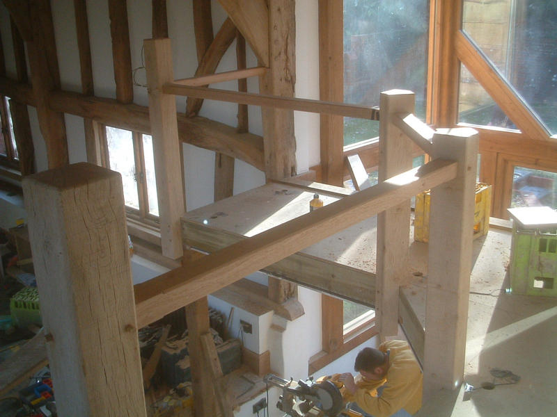 Balcony newel posts and handrails, mortised, tenoned, and doweled