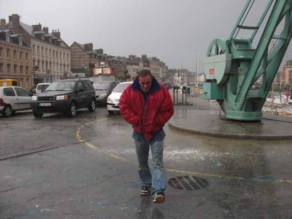 Stig walking in the rain in St Valerie
