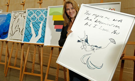 Tracey Emin posing with her 2012 poster. Oh dear, oh dear, shot a load of white.