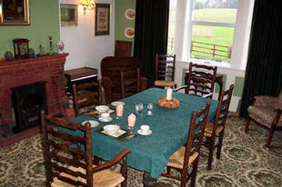 Dining Room looking out to green fields & wood