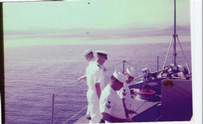 Unknown sailor,Ensign Glenn and unknown BM2, Bannister, BM1, slide was reversed when print was made