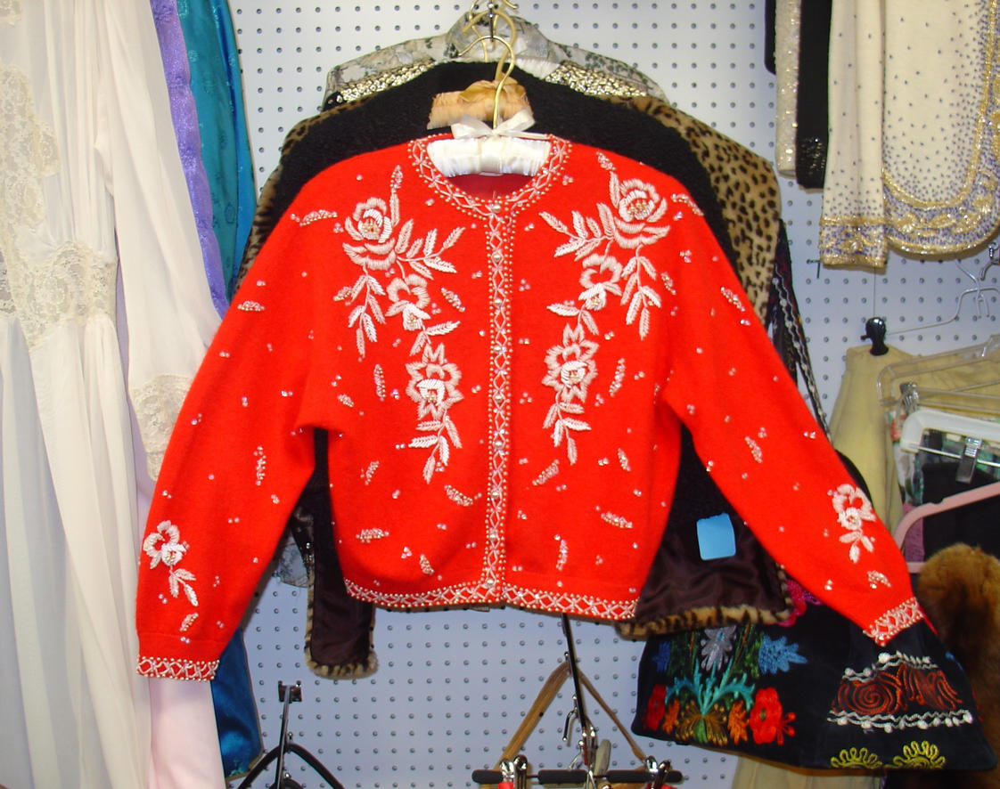 Red beaded sweater white beads