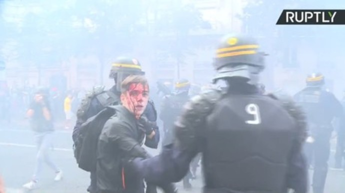 smoke and blood as french police beat back peaceful union demo