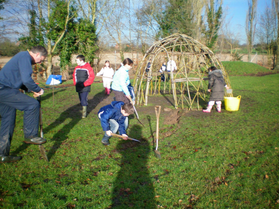 Ganesh & children preparing the trench for living willow fedge walkway