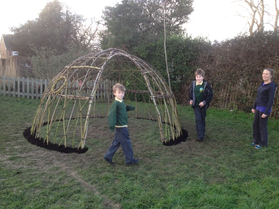 Family at Chidham Parochial Primary School enjoying their new school willow dome that was created last week in the sunshine!