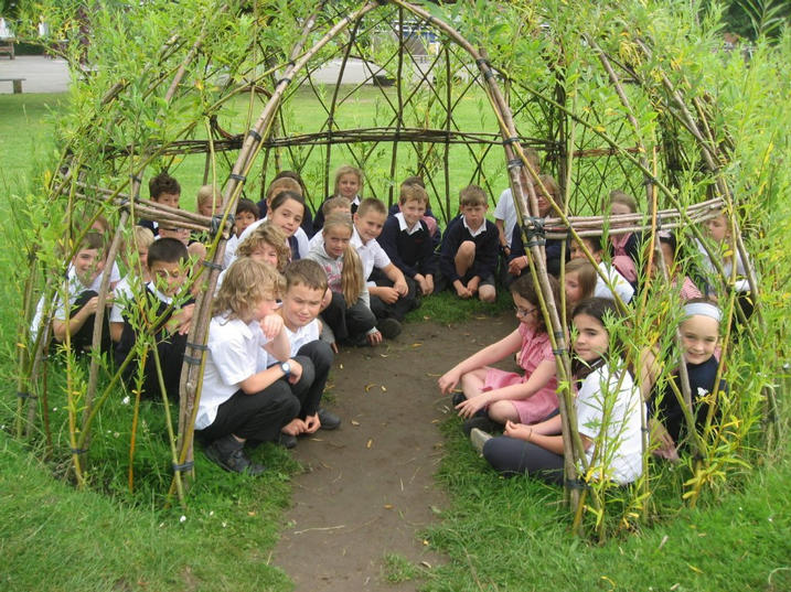34 year 4/5/6 children  sitting in our standard sized willow dome this photo was taken in July and the willow dome was planted in January.  As you can see there is still room for more children as the children are not sitting on the path. Tunnel attached.