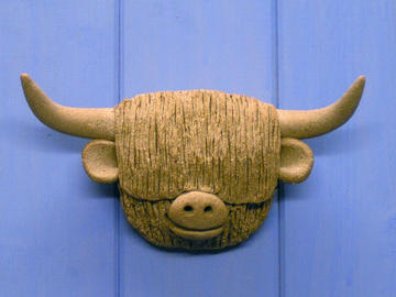 Wall mounted highland cow heads
