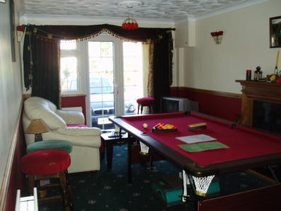 Games room with pool table and dartboard