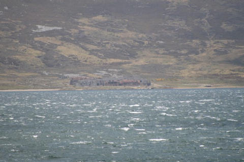 Looking from Blue Beach across San Carlos Water to Red Beach and above it the Canning Factory that was The Red and Green Life Machine (Emergency Hospital) at Ajax Bay