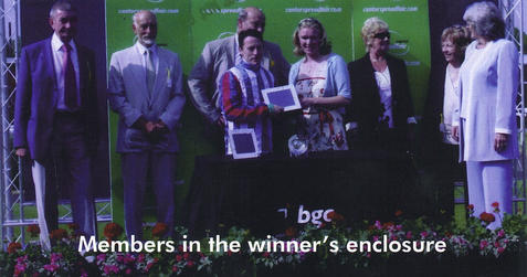 Members accepting the prize after Fratt'n Park wins at Newbury
